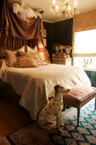 Silk drapings surround the well appointed bed.